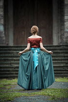 Magdalena Russocka historical woman standing at stone steps outside