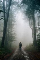 Andrei Cosma MAN WALKING ON COUNTRY ROAD IN WINTER Men