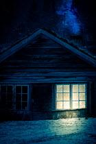 Des Panteva LIGHT IN CABIN AT NIGHT IN WINTER Houses