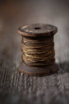 Jaime Brandel CLOSE UP OF OLD COTTON REEL Miscellaneous Objects