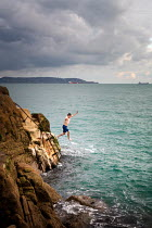 Evelina Kremsdorf Young man diving into sea from cliff