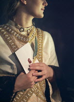 Mark Owen Young woman in medieval gown holding envelope and quill