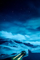 Des Panteva CAR ON SNOWY COUNTRY ROAD AT NIGHT Cars