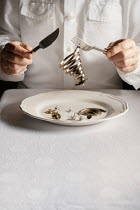 Maria Petkova MAN EATING CLOCK MECHANISMS WITH CUTLERY Men