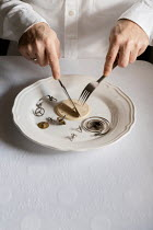 Maria Petkova MAN EATING CLOCK MECHANISMS WITH CUTLERY Body Detail