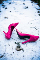 Magdalena Russocka pink stiletto shoes lying on snow
