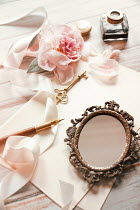 Sandra Cunningham Small ornate mirror with key and flowers