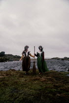 Rekha Garton Witches with broomstick by sea