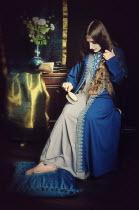 Magdalena Wasiczek BRUNETTE GIRL SITTING BRUSHING HAIR Women