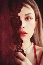 Ebru Sidar Young woman behind red lace