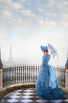 Lee Avison Victorian woman looking towards the Eiffel Tower, Paris