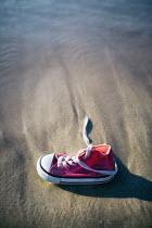 Magdalena Russocka childs sneaker on sandy beach