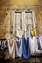 Irene Lamprakou Clothesline outside apartment window Building Detail