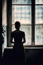 Magdalena Russocka woman standing by window in old building
