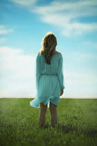Ildiko Neer Young woman standing countryside in wind