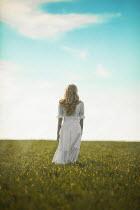 Ildiko Neer Young woman walking countryside in wind