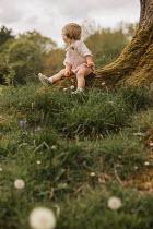 Shelley Richmond Toddler sitting on tree
