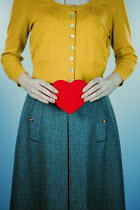Magdalena Russocka retro woman holding red heart Women
