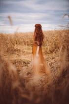 Rebecca Stice GIRL WITH RED HAIR STANDING IN WHEAT FIELD Women