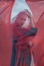 Inna Mosina SERIOUS GIRL COVERED WITH RED SILK OUTDOORS Women