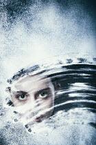Magdalena Russocka teenage girl behind snowy window