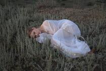 Inna Mosina WOMAN IN WHITE LYING IN COUNTRYSIDE Women