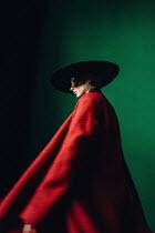 Daniil Kontorovich WOMAN IN RED COAT WITH LARGE HAT Women