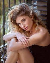 Anna Volynskaia Young woman sitting on balcony