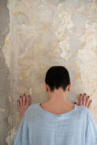 Mohamad Itani Young woman by wall in abandoned house