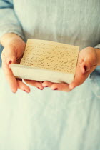 Mohamad Itani Woman's hands holding letter