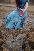 Natasza Fiedotjew Vintage woman standing in moorlands