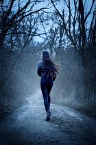 Natasza Fiedotjew Woman in black running away in woods
