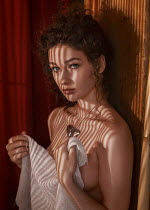 Anna Volynskaia Topless woman covering herself with sheet