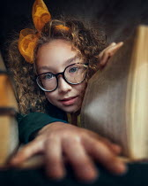 Anna Volynskaia Girl with glasses holding open book