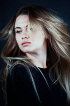 Magdalena Russocka close up of blonde woman with blown hair