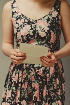 Shelley Richmond WOMAN IN FLORAL DRESS HOLDING LETTER Women
