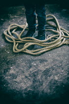 Mohamad Itani LITTLE BOY STANDING WITH ROPE BY FEET Children