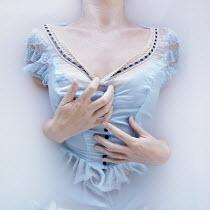 Meg Cowell WOMAN IN LACY DRESS DRESS FLOATING IN MILKY WATER Women