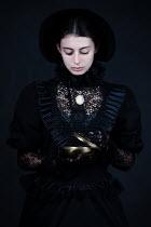 Magdalena Russocka historical woman holding casket inside