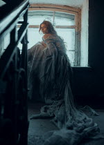 Ekaterina Pavlova WOMAN IN RAGGED DRESS INDOORS BY WINDOW Women