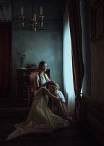 Ekaterina Pavlova TWO WOMEN SITTING BY WINDOW INDOORS Women