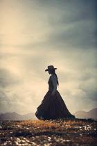 Magdalena Russocka historical woman wearing cowboy hat standing in field