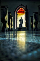 Yolande de Kort MONK WALKING THROUGH DOOR INSIDE CHURCH Men