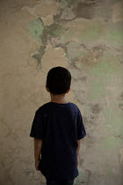 Mohamad Itani LITTLE BOY STANDING BY SHABBY WALL Children