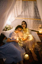 Jovana Rikalo TWO WOMEN HOLDING CANDLES INSIDE TENT Women