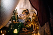 Jovana Rikalo FOUR WOMEN IN TENT WITH CANDLES AND FRUIT Women