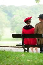 Lee Avison RETRO COUPLE SITTING ON BENCH IN PARK Couples