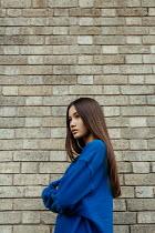 Shelley Richmond ASIAN TEENAGE GIRL BY BRICK WALL OUTDOORS Women