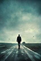 Silas Manhood MAN WALKING ON COUNTRY ROAD IN WINTER Men