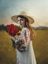 Dmytro Baev Young woman in straw hat with bouquet of red flowers